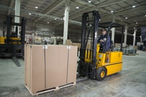Forklift operator working at warehouse
